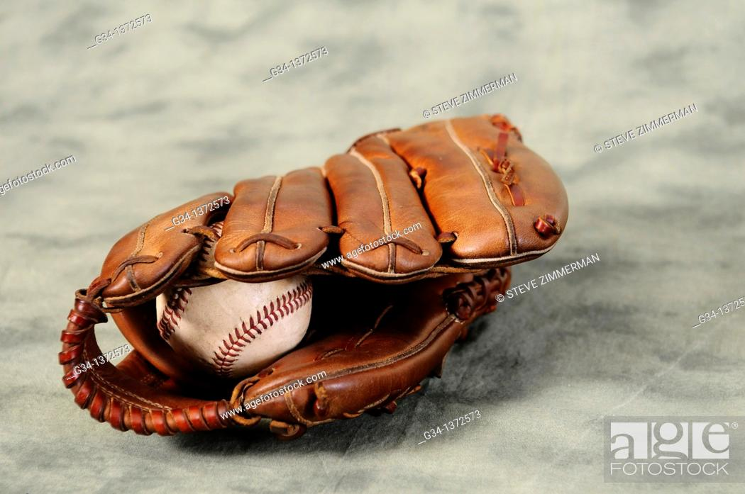 Stock Photo: Baseball glove and ball.