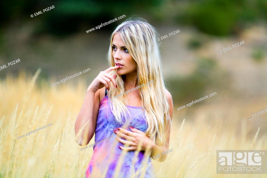 Stock Photo: Attractive young woman in nature.
