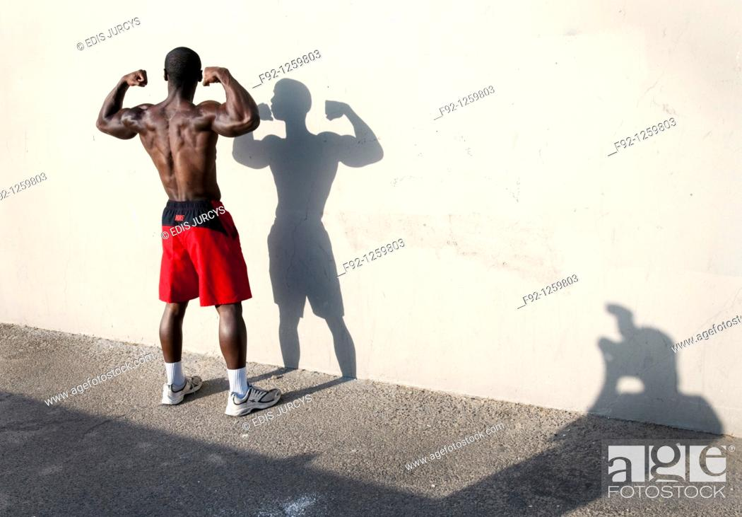 Stock Photo: Muscural man possing for the camera in Venice beach, California.