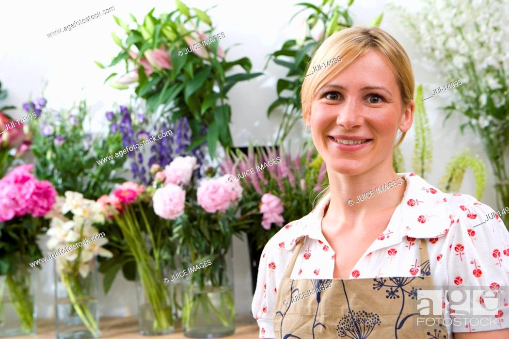 Stock Photo: Female florist in shop, smiling, portrait.