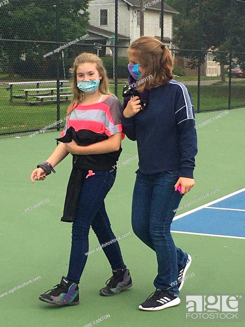 Imagen: 6th Grade Girls Walking Together and Wearing Masks, Wellsville, New York, USA.