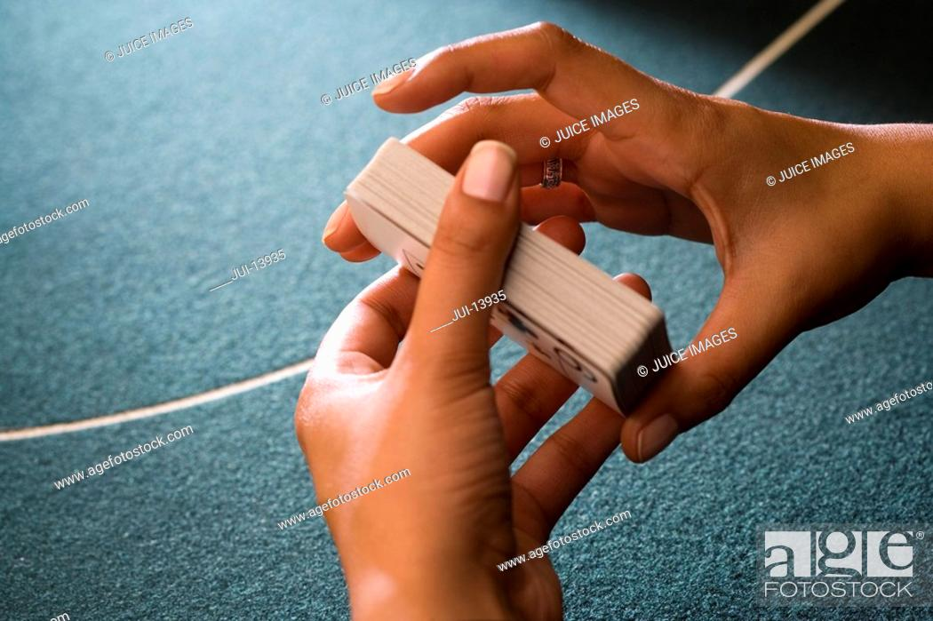 Stock Photo: Croupier shuffling cards, close-up of hands.