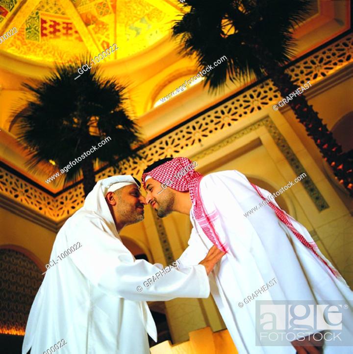 Stock Photo: Arab men rubbing their noses (traditional Arab greeting).