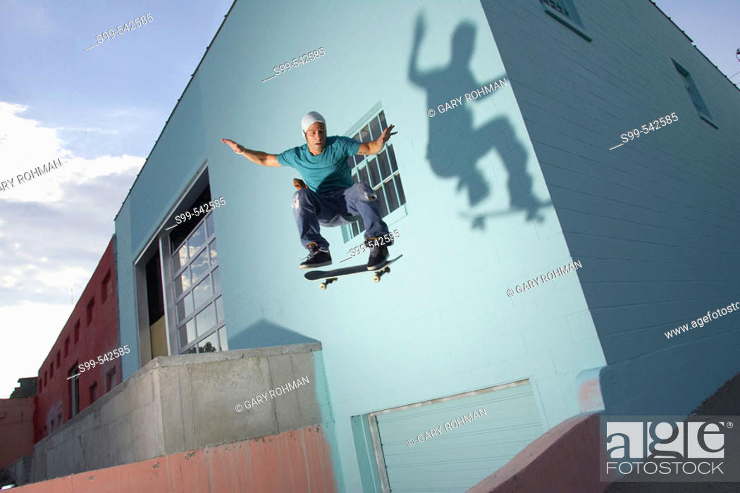 Stock Photo: Skater skateboarding behind a building in downtown Kansas City, Missouri, USA.