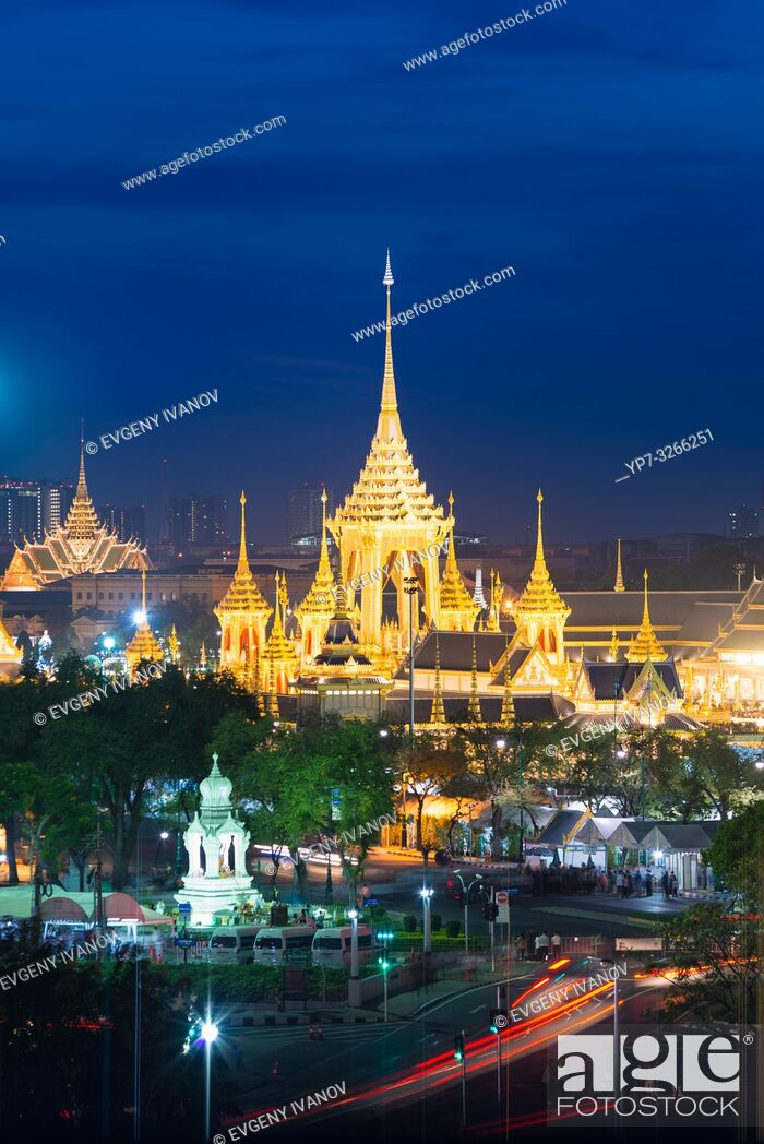 Stock Photo: Bangkok night view from above with golden buddist temples, chedis and night traffic.