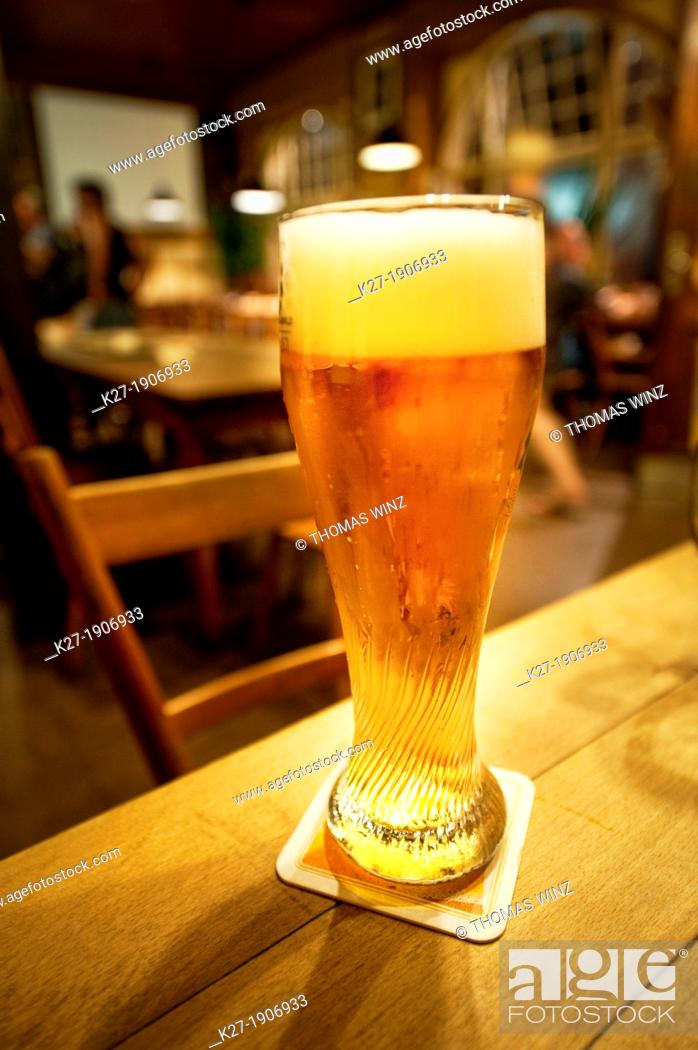 Stock Photo: Glass of wheat beer on a table in an old restaurant , Stuttgart , Germany.