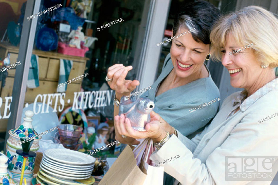 Stock Photo: Two mature women shopping in a store.