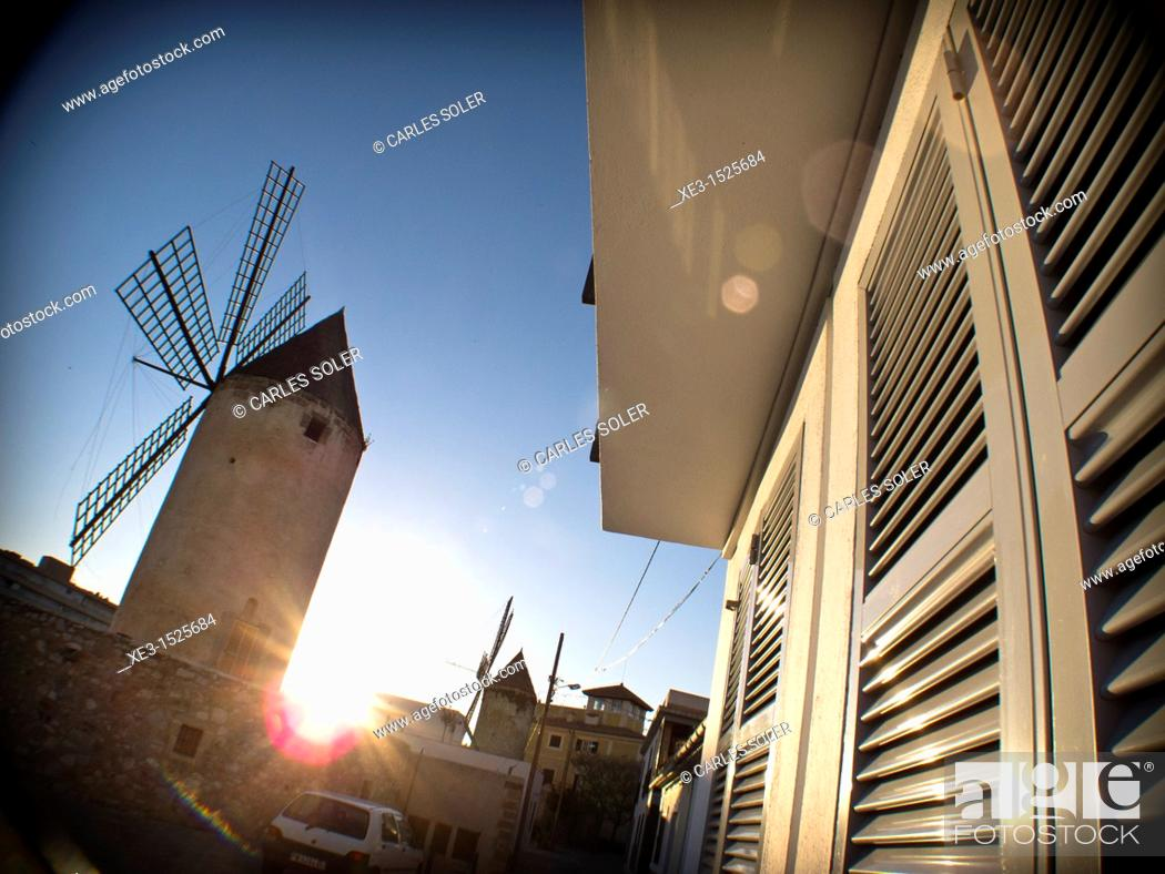 Stock Photo: Majorcan windmill at sunset.