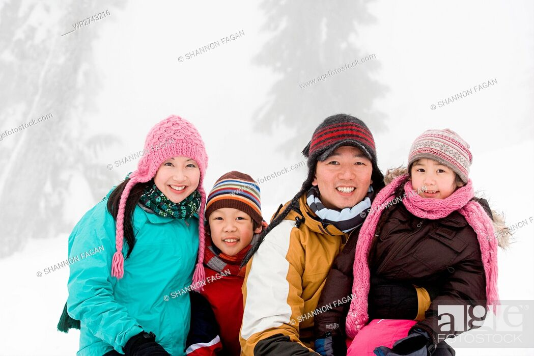 Stock Photo: Family in the snow.