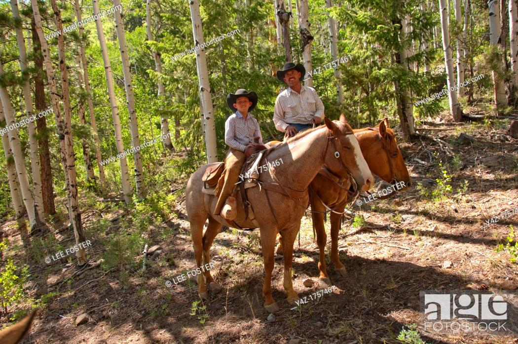 Stock Photo: USA, Utah, horseback ride in Escalante with wranglers Jamie Barnson and Cash Barnson through ponderosa pine forest up steep trail to Aquarius Plateau   MR.