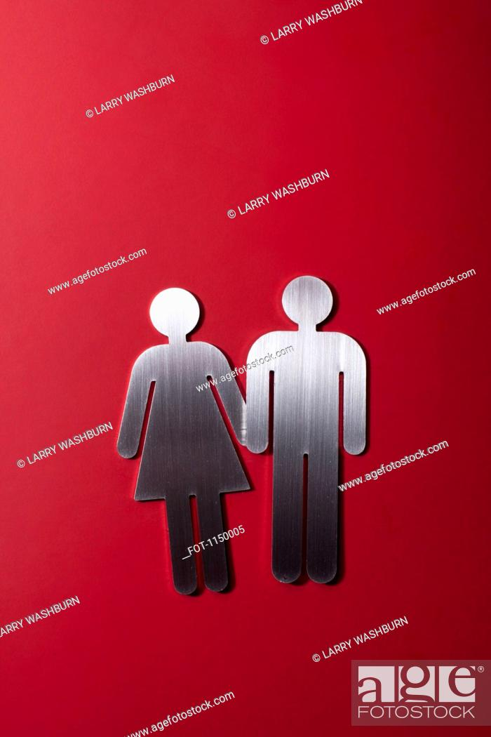 Stock Photo: Female and male restroom sign figures holding hands.