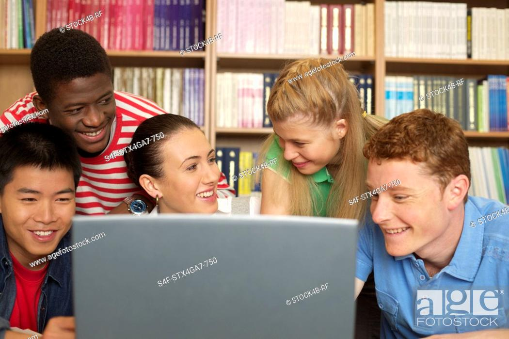 Stock Photo: Female student using a computer.