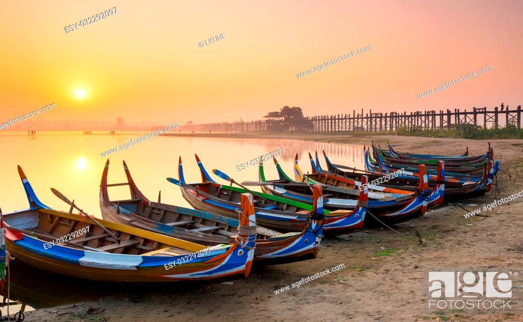 Stock Photo: Wooden boat in Ubein Bridge at sunrise, Mandalay, Myanmar (World longest wooden bridge).