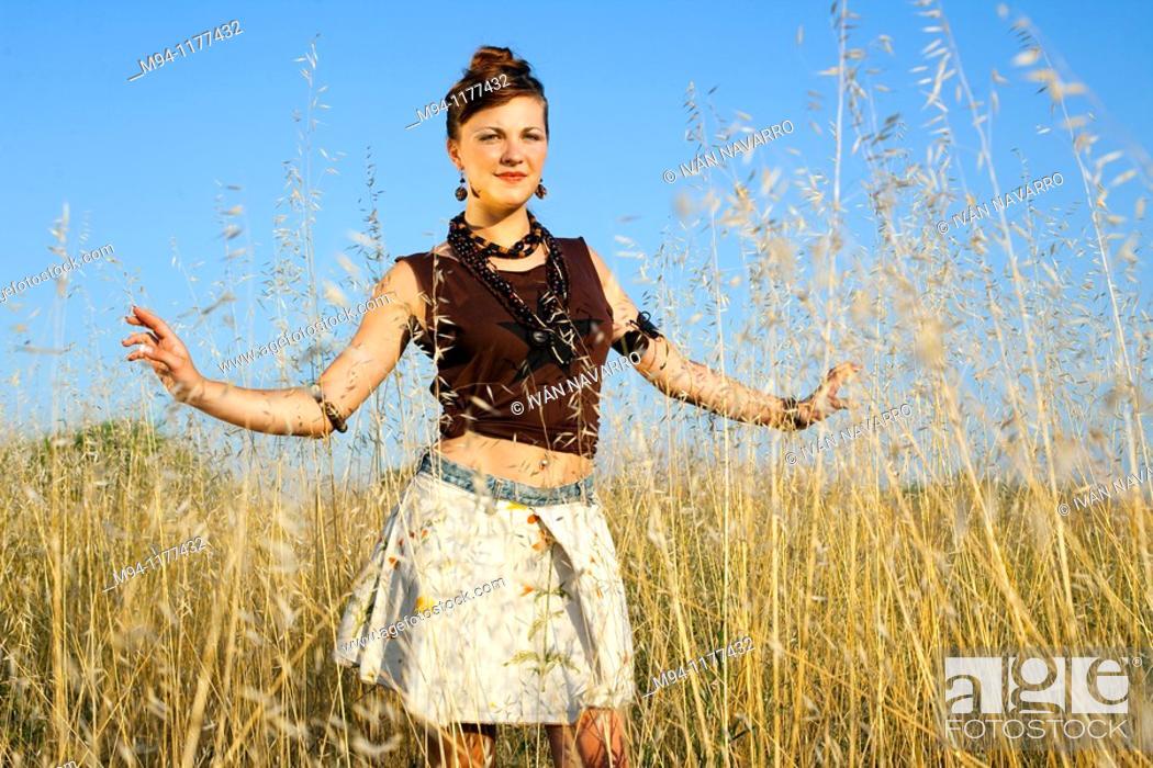 Stock Photo: Woman posing, facing camera.