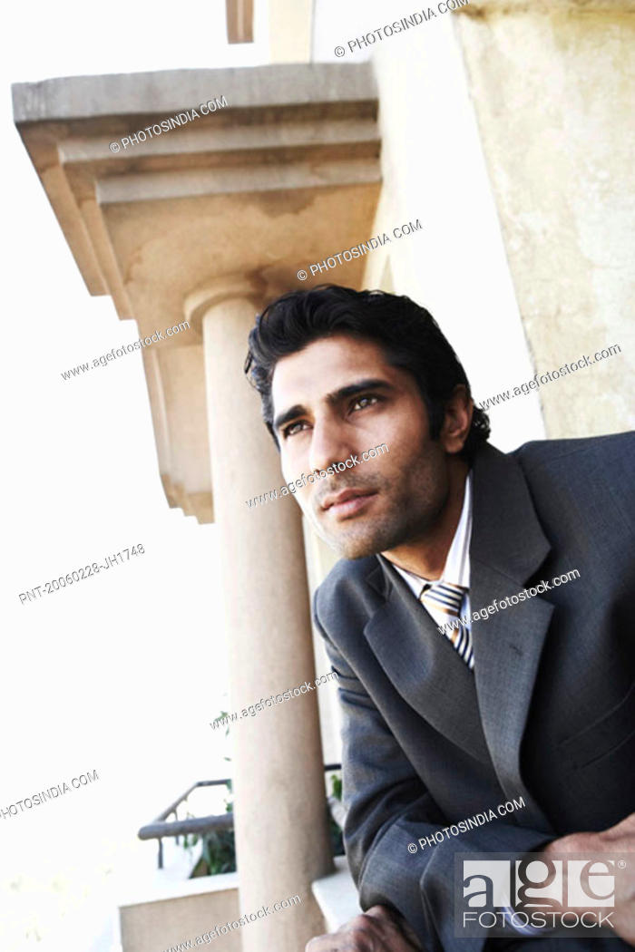 Stock Photo: Close-up of a young man looking away.