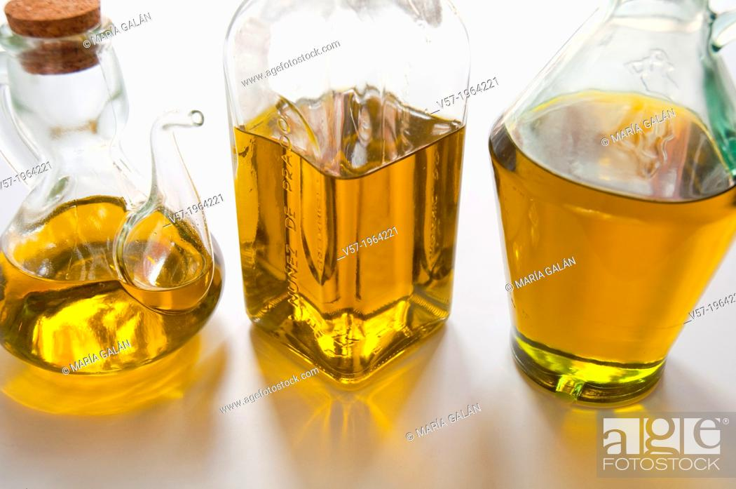 Stock Photo: Three oil bottles. Close view.