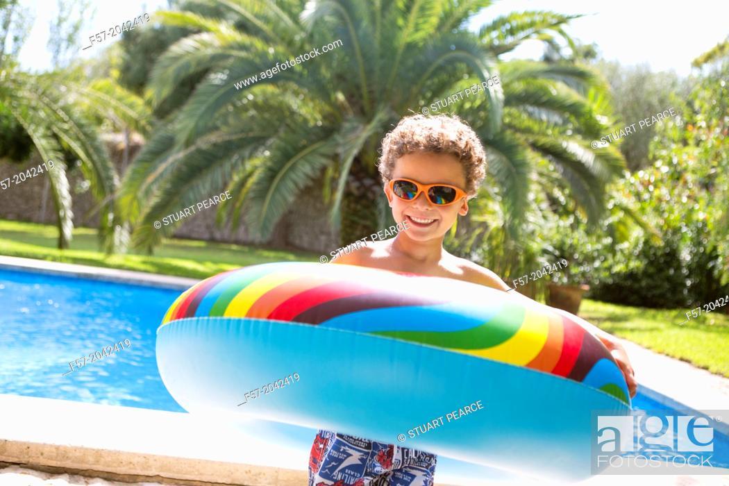 Stock Photo: Young boy enjoys summer.