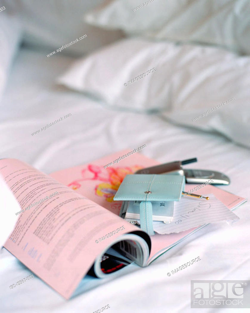 Stock Photo: Magazine on crumpled bed.