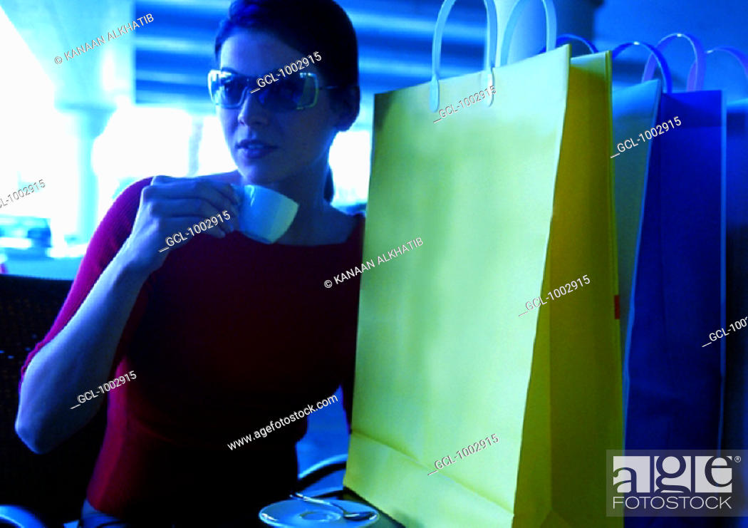 Stock Photo: Woman having a coffee after shopping.