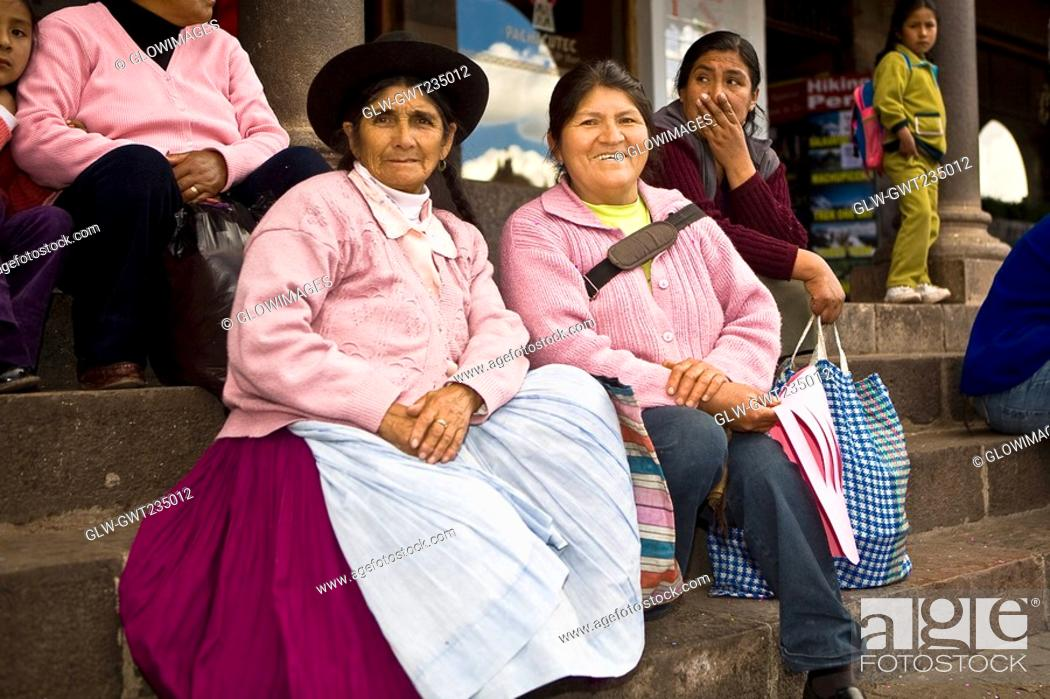 Stock Photo: Portrait of a senior woman with a mid adult woman sitting on steps, Peru.