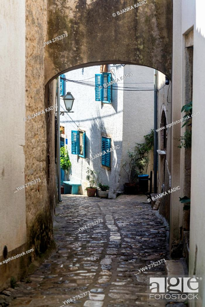 Stock Photo: Narrow lane with cobblestones in the Old Town, Town of Krk on the island of Krk, Croatia.