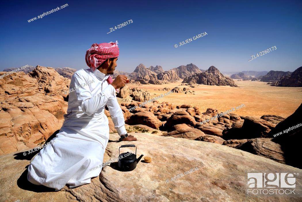 Stock Photo: Bedouin having a tea break at the top of mount Jebel Burdah. Jordan, Wadi Rum desert, protected area inscribed on UNESCO World Heritage list.