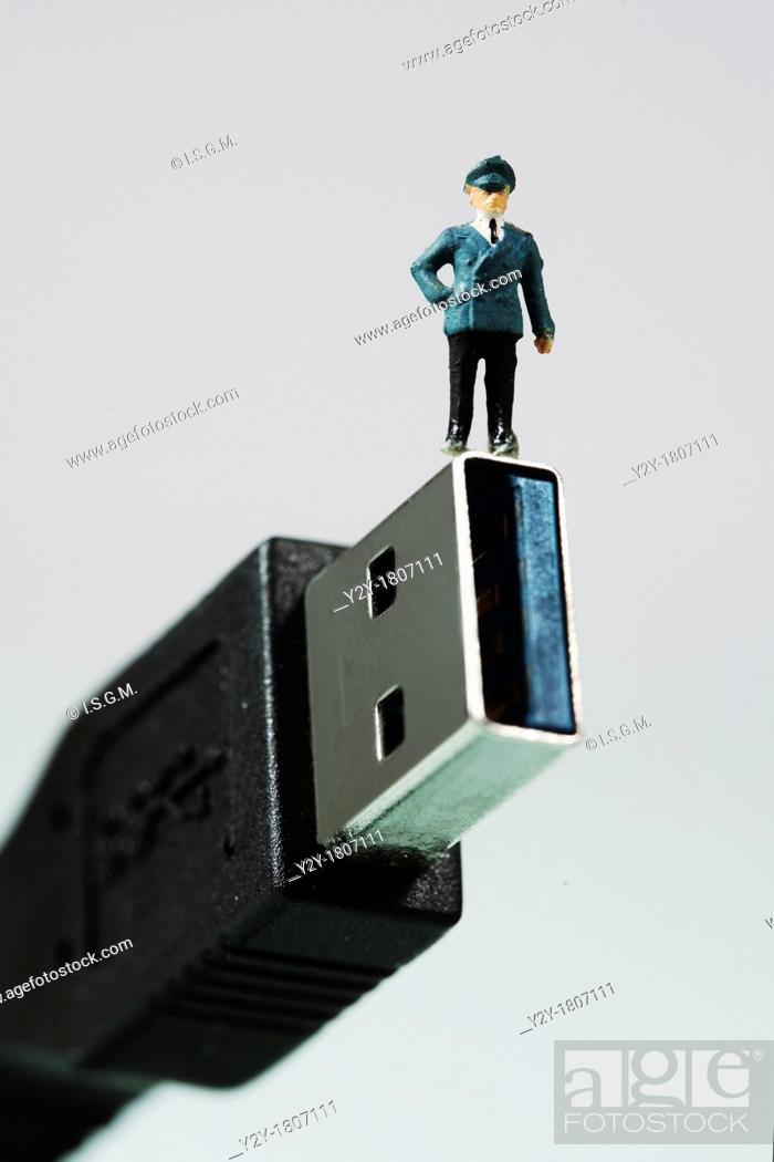 Stock Photo: Small figurine on USB3.