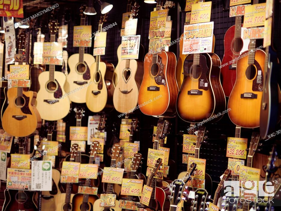Stock Photo: Acoustic guitars on display in a music instrument store in Kyoto, Japan.