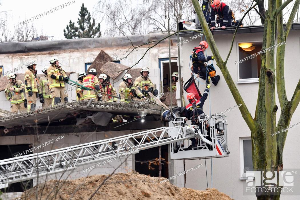 Stock Photo: Rescue forces and the height rescue of the fire brigade operate on a house after a scaffolding had fallen in the district of Moabit in Berlin, Germany.