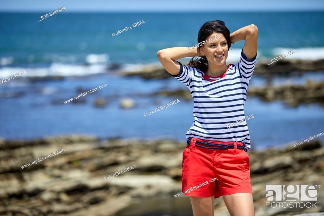Stock Photo: Young woman by the sea, Route de La Corniche, Cantabrian Sea Coast, Hendaye, Aquitaine, Basque Country, France.