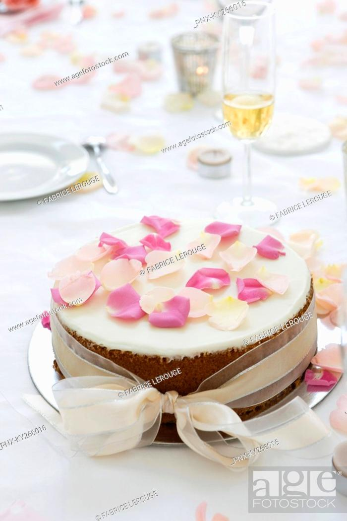 Stock Photo: Close-up of a wedding cake on a dining table.