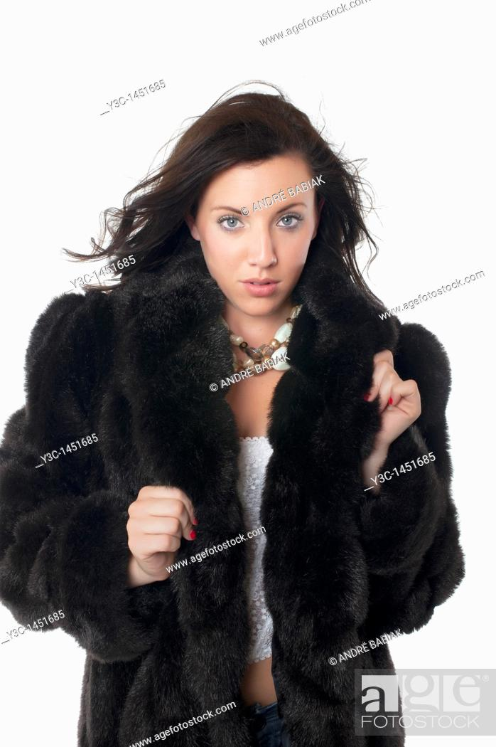 Stock Photo: Sexy woman wearing fur coat.