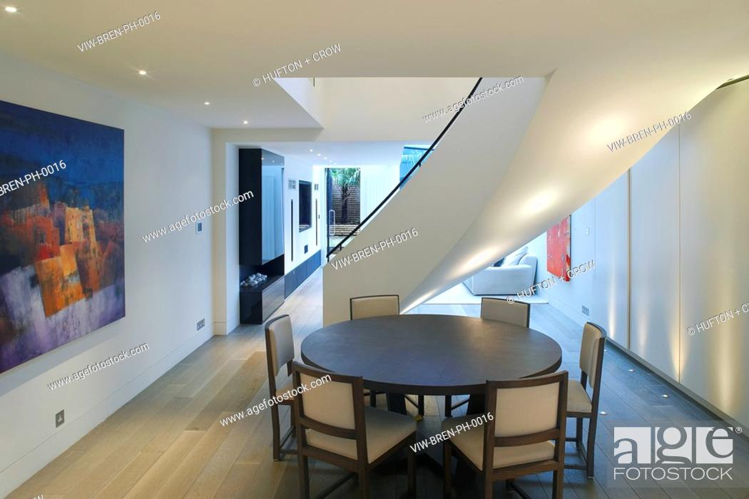 private house kensington dining table under spiral staircase stock rh agefotostock com