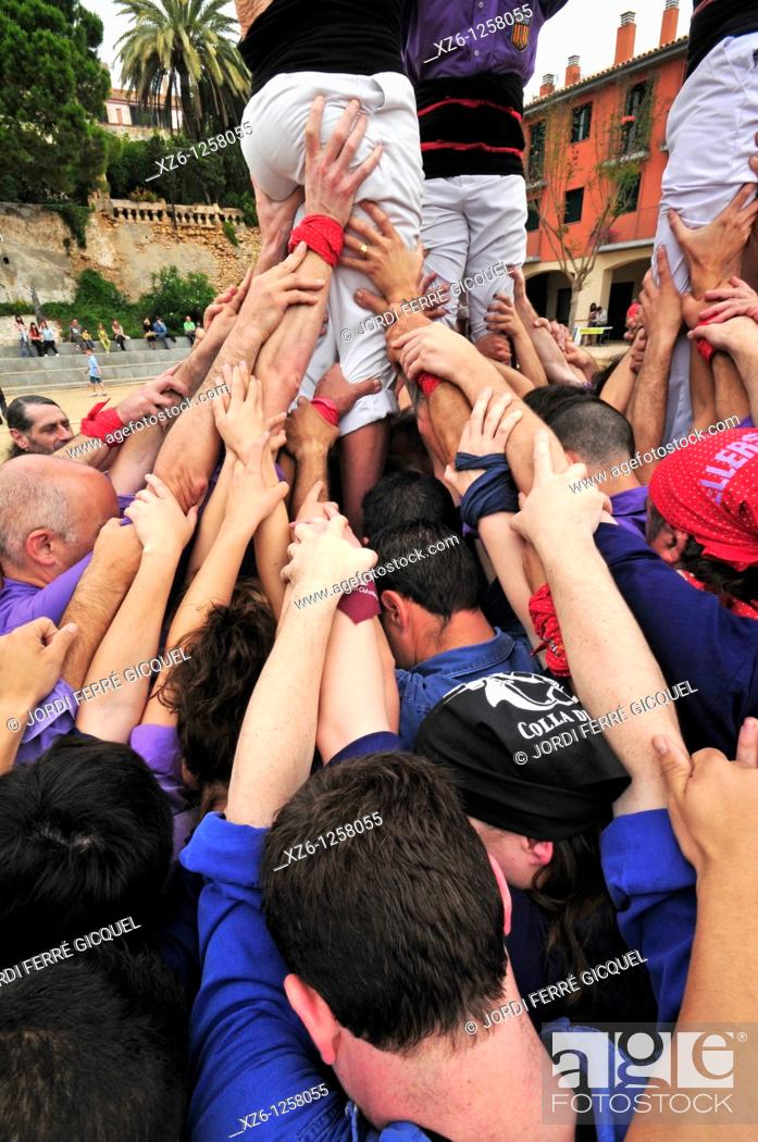 Stock Photo: Detail of Castellers, Catalan human castles declared UNESCO element of Intangible Cultural Heritage of Humanity.