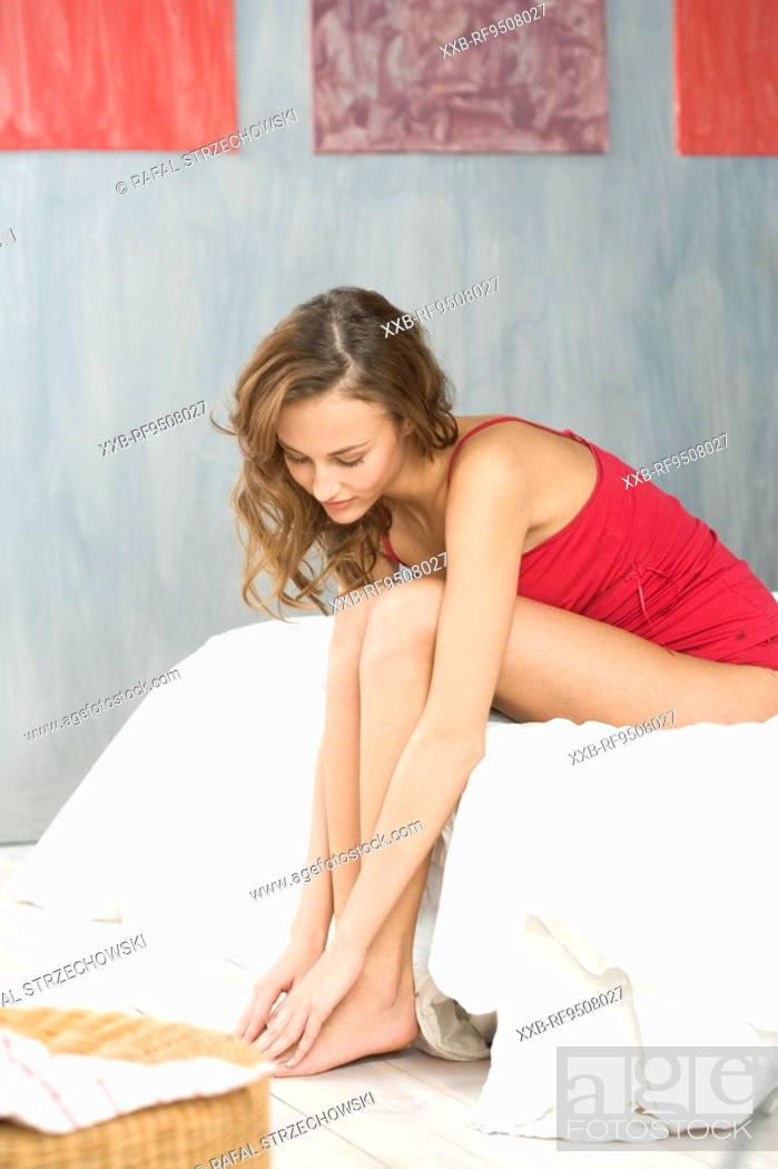 Stock Photo: young woman in bedroom.