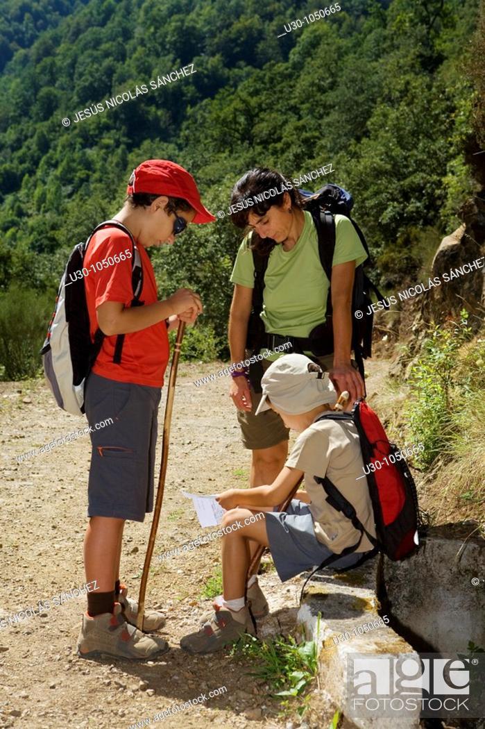 Stock Photo: family walking along a route in Liébana valley  Picos De Europa National Park  Cantabria  Spain.