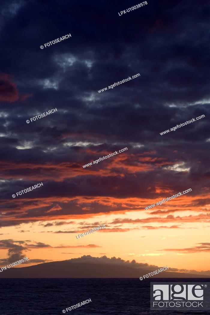 Stock Photo: Sunset over Pacific Ocean with clouds in Maui, Hawaii, USA.
