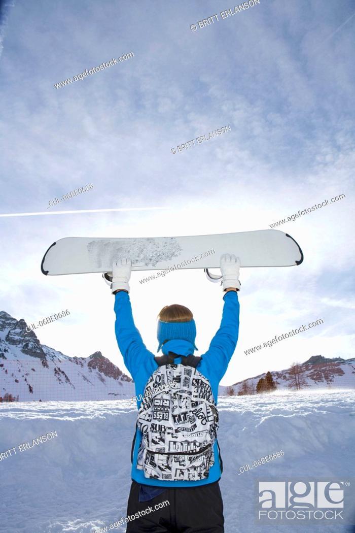 Stock Photo: Man holding ski board.