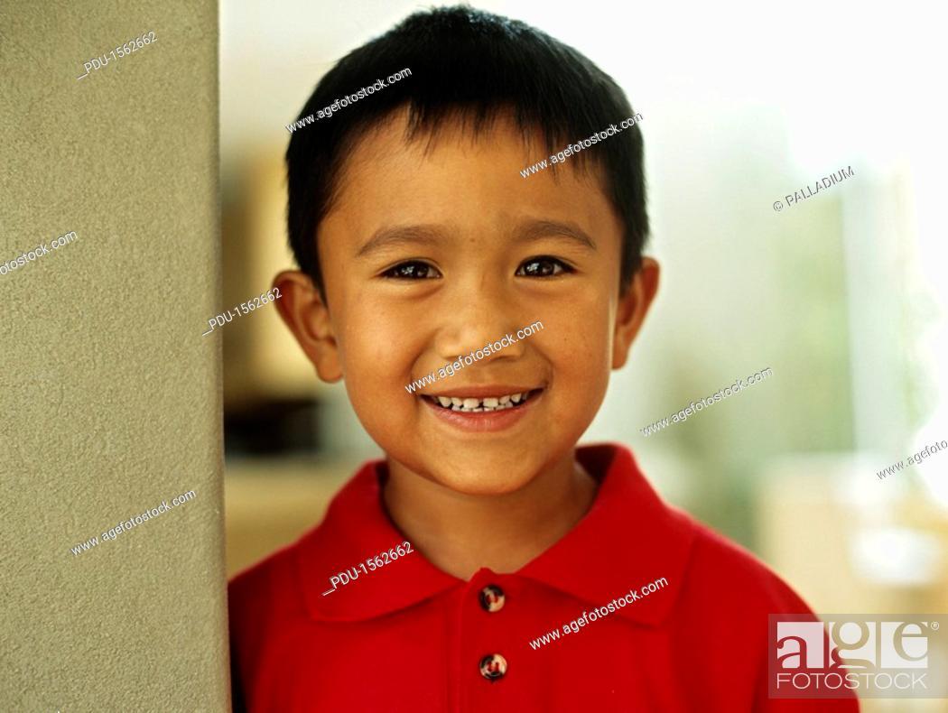 Stock Photo: Boy 6-7 smiling,portrait,close-up.