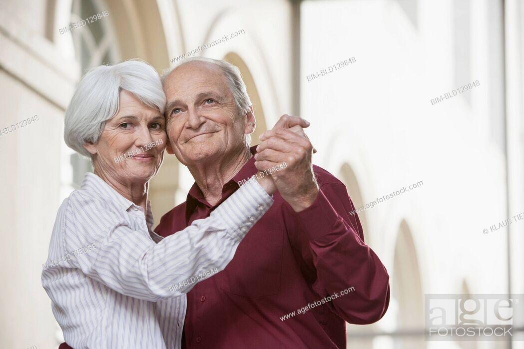 Stock Photo: Senior Caucasian couple dancing.
