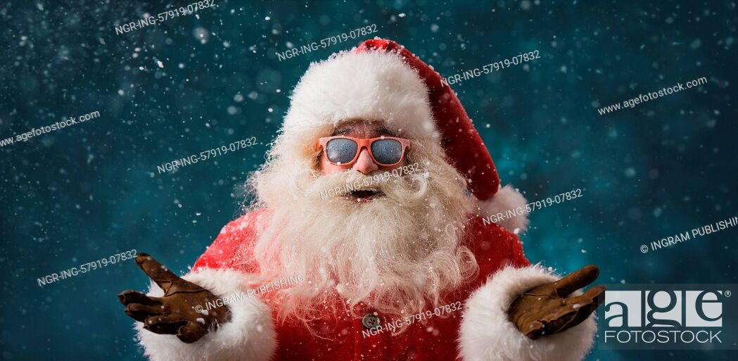 Stock Photo: Santa Claus wearing sunglasses dancing outdoors at North Pole in snowfall. He is celebrating Christmas after hard work.