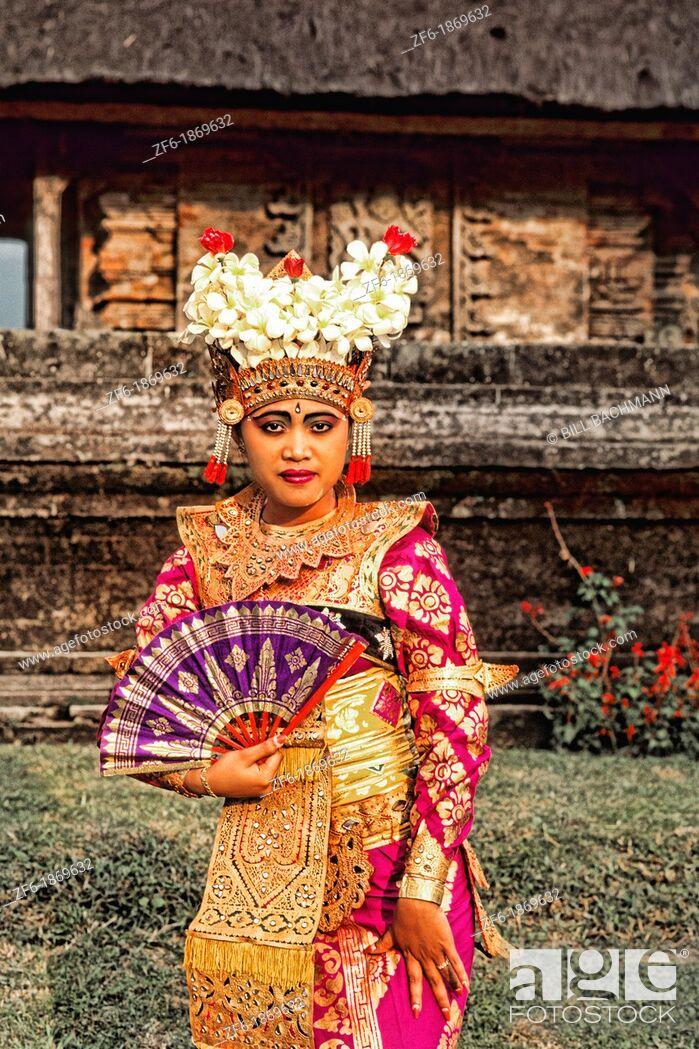 Stock Photo: Bride in full traditional dress in beautiful religious temple in Bali Indonesia Lake Bratan Ulur Danu Temple.