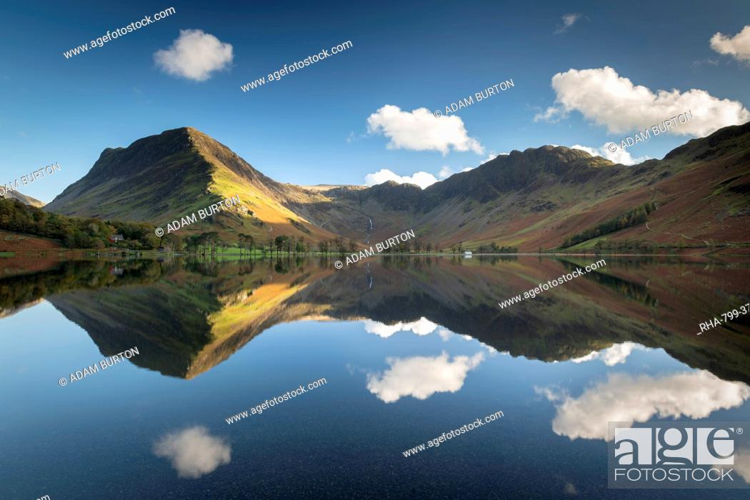 Stock Photo: Perfect reflections on a tranquil Buttermere in the Lake District National Park, UNESCO World Heritage Site, Cumbria, England, United Kingdom, Europe.