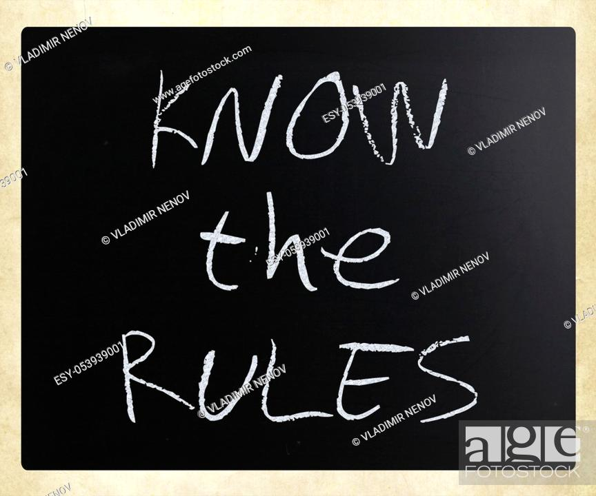 """Stock Photo: """"""""""""""""""""Know the rules"""""""" handwritten with white chalk on a blackboard."""