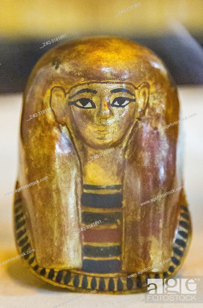 Stock Photo: Egypt, Cairo, Egyptian Museum, from the tomb of Yuya and Thuya in Luxor : Small plastered gilded mask, which was inside a canopic vase of Thuya.