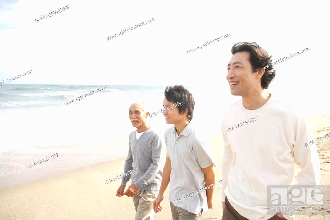 Stock Photo: Young man with father and grandfather at beach.