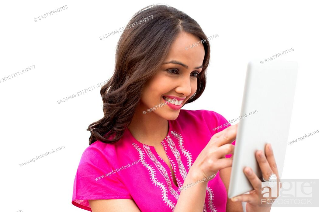 Stock Photo: Smiling woman using a digital tablet.