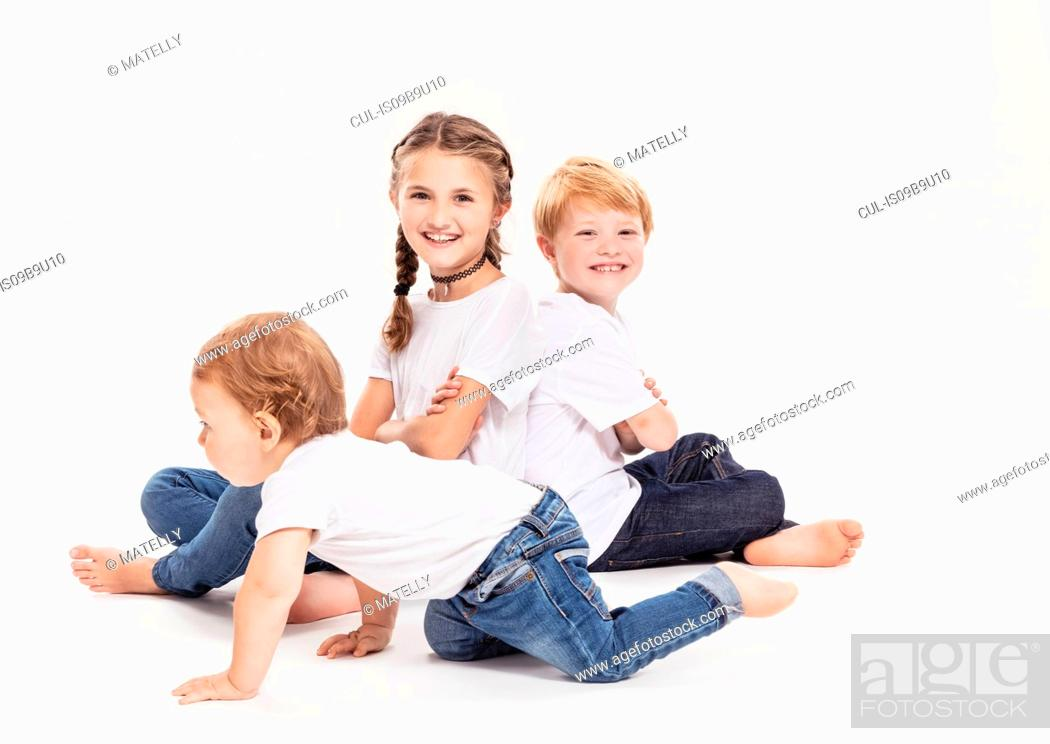 Stock Photo: Portrait of brothers and sister.