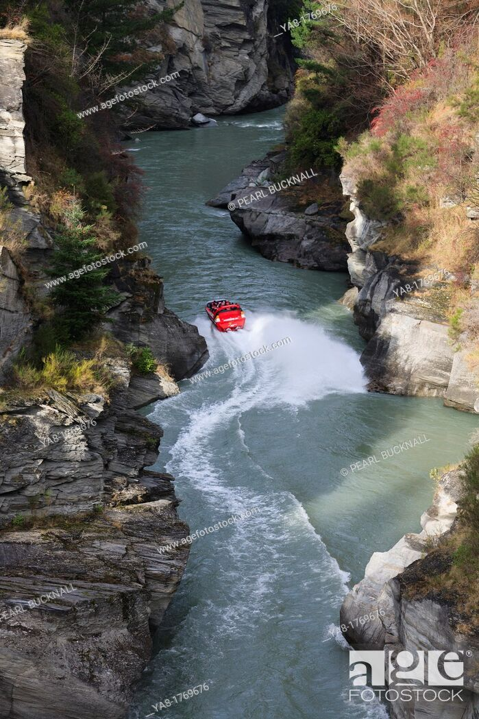 Stock Photo: Arthurs Point Queenstown South Island New Zealand  View down into the Shotover River canyon with jet boat giving rides.