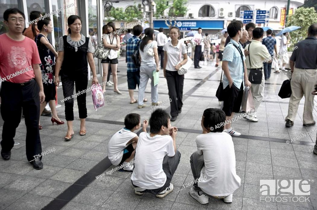 Stock Photo: Youth rest at the entrance of a mall.